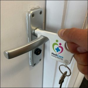 Group Image showing opening door using Antimicrobial Branded Recycled Hygiene Hook Keyrings from Eco Promos