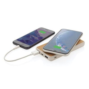 8000mah Eco Branded Wireless Power Banks from Eco Promos wirelessly charging a mobile phone with another charging by cable