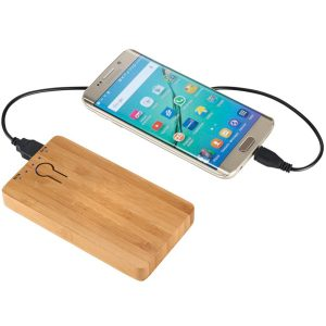 Image of Grove Bamboo branded Power Banks charging a Mobile phone.