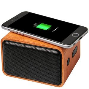 Image of Wooden Eco Branded Speaker and Wireless Charger charging phone.